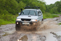 Mitsubishi Pajero moving by water making lots of splashes Royalty Free Stock Photography