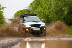Mitsubishi Pajero Sport moving by water making lots of splashes Royalty Free Stock Image