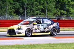 Mitsubishi race car. Mitsubishi EVO race care on the speedway in search of the checkered Flag Royalty Free Stock Photos