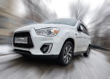 Mitsubishi white car. Mitsubishi white car crossover on blurred background Royalty Free Stock Images