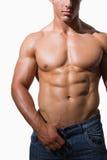 Mitt- avsnitt av en shirtless muskulös man fotografering för bildbyråer