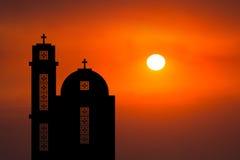 Mitt - soluppgångsolnedgång för östlig kyrka royaltyfri fotografi