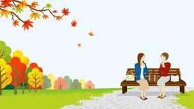 Mittagessen mit zwei Frauen im Herbstpark stock abbildung