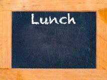 Mittagspausekreidebrett Stockbild