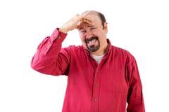 Mitte alterte Mann in der Bedrängnis mit der Hand auf Stirn Stockfotografie