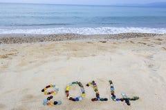 Mitteilung 2014 auf dem Strand Stockfotografie