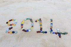 Mitteilung 2014 auf dem Strand Stockfotos