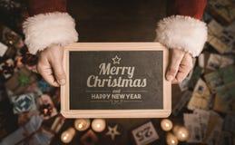 Mitteilung der frohen Weihnachten und des guten Rutsch ins Neue Jahr Stockbilder