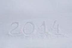 Mitteilung 2014 des neuen Jahres auf Schnee Lizenzfreies Stockbild