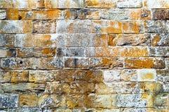 Mittelalterliche Wand des Kalksteins des Steins blockiert die leere Beschaffenheitshintergrundoberfläche Stockfoto