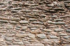 Mittelalterlicher unregelmäßiger Steinwandhintergrund lizenzfreie stockfotos