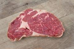 Mittelrippe vom Rind, Steak, Abschluss des rohen Fleisches oben Lizenzfreie Stockbilder