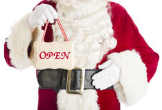 Mittelteil von Santa Claus Holding Open Sign Stockfotografie