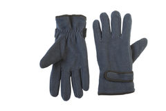 Mitten. Two dark blue gloves are isolated on a dark blue background Stock Photos