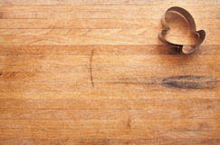 Mitten Cookie Cutter on Worn Butcher Block Stock Photo