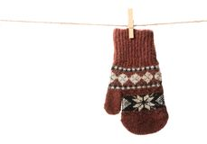 The mitten. One brown mitten with ethnic ornament isolated on white background Stock Photo