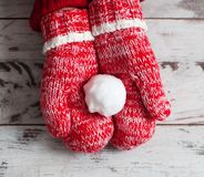 Mitten on wood floor. Mitten with snowball on wood floor. Winter decoration royalty free stock photography