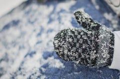 Mitten under snow. Royalty Free Stock Photos