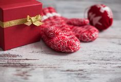 Mitten on wood floor. Mitten with christmas ball on wood floor. Winter decoration royalty free stock photo