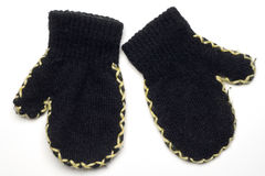 Mittens. A pair of black wool child's mittens on white Stock Photo