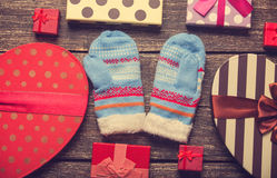 Mittens and gifts Royalty Free Stock Photo