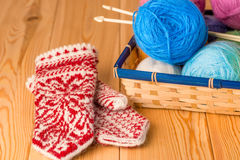 Mittens handmade near the basket Stock Image