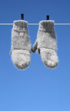 Mittens hanging to dry. Mittens on the clothes-line hanging to dry - the winter is over royalty free stock photo