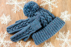 Mittens, knitting cap and christmas-tree decorations Stock Photography