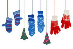 Mittens and a pair of Christmas trees Royalty Free Stock Photos