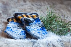 Mittens with pattern in the snow Stock Images