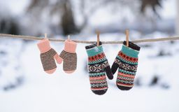 Mittens on rope in winter Royalty Free Stock Image