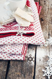Mittens, Snowflakes and Plaid on Wooden Background Stock Photography