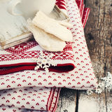 Mittens, Snowflakes and Plaid on Wooden Table Royalty Free Stock Photography