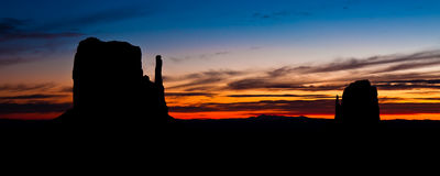 The Mittens at Sunrise. The East and West Mittens at sunrise in Monument Valley Tribal Park, Arizona Stock Image