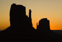 Mittens at sunrise. Sunrise behind the Mittens in Monument Valley Royalty Free Stock Images