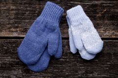 Mittens on wood background. Blue mittens on wood background Stock Photography