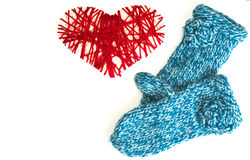 Mittens and woven red heart valentine card Royalty Free Stock Images