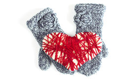 Mittens and woven red heart valentine card Royalty Free Stock Photo