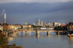 Mittlere Bridge and Basel skyline, Switzerland. View over the Rhine river passing through the city of Basel, Switzerland. The central point of this image is the Stock Photos