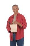 Mittlerer gealterter Mann mit Weinflasche Stockfotos