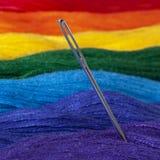 Mitty floss lade ut i färgerna av regnbågen Nära övre för visare arkivfoto