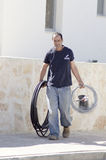 Mitzpe Ramon, Israel The installation of new solar water heaters compa - Work Ronnie Sasi with black cables Royalty Free Stock Image