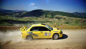 Mitzubishi Lancer rally car on race. A Mitzubishi Lancer Evo IX  during the 2th stage of Nido dell'Aquila in Nocera Umbra (Italy) a competition race of hill Royalty Free Stock Photography