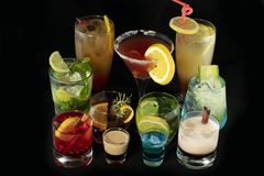 Mix alcoholic cocktails together with isolated black background stock image