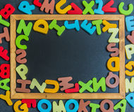 Mix Alphabet colorful wooden word on black board Stock Image