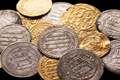 Mix of ancient golden and silver islamic coins Royalty Free Stock Images