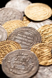 Mix of ancient golden and silver islamic coins Stock Photography