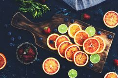 Mix of assorted citrus fruits - red oranges and limes Royalty Free Stock Photography