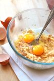 Mix of banana and eggs in a glass bowl Stock Photos