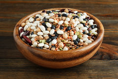 Mix of beans in a wooden bowl Stock Photography